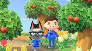 A cat and a person are wearing blue ME Awareness tops
