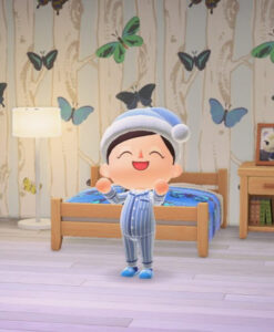 An ACNH person dressed in blue pyjamas and night cap