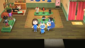 A person and a cat in a clothes shop wearing blue M.E. Awareness clothes